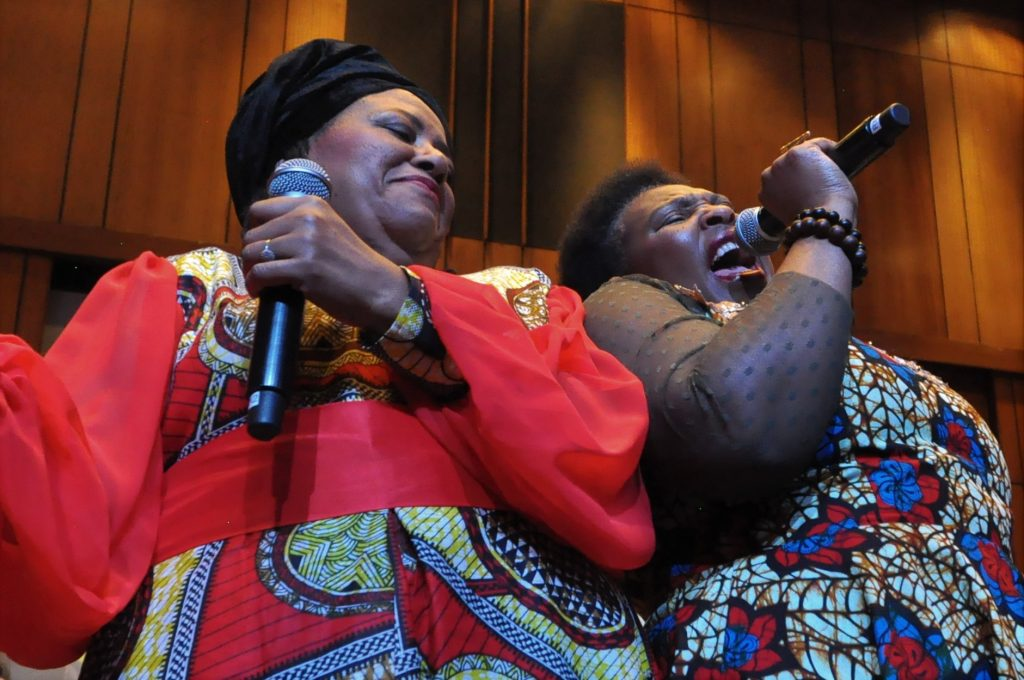 JOHANNESBURG, SOUTH AFRICA - JUNE 21: Sibongile Khumalo (left) and Yvonne Chaka Chaka during the World Refugee Day commemoration concert held at Linder Auditorium on June 21, 2019 in Johannesburg, South Africa. The event, which is South Africa?s first concert for refugees, being held to mark the United Nations' World Refugee Day which was on June 20, also highlights the plight of refugees in the country. (Photo by Gallo Images/Laird Forbes)